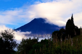 Tungurahua volcano appears from behind the clouds (2016).